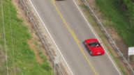 MS AERIAL TS Shot over red Corvette driving on road / Bowling Green, Kentucky, United States