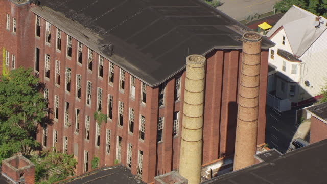 MS AERIAL Shot over Silk Machinery Exchange smoke stacks / Paterson, New Jersey, United States