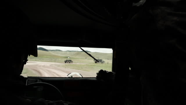 Shot over the driver's shoulder while driving in a Humvee.