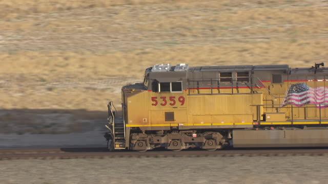 CU AERIAL ZI Shot over train southwest of Great Salt lake en route from Salt lake City to Bonneville Salt Flats / Utah, United States
