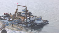 MS AERIAL PAN Shot over tug boats at port / Anchorage, Alaska, United States