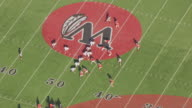 MS AERIAL DS Shot over Weehawken football players on field / Weehawken, New Jersey, United States