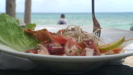 CU Shot pf  shrimp and octopus salad with the sea in the background / Playa del Carmen, Quintana Roo, Mexico