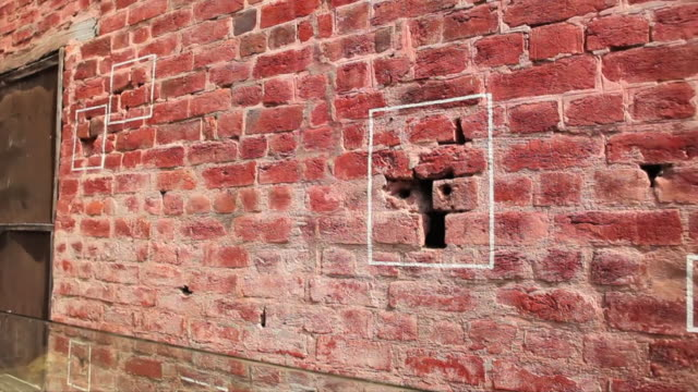 MS PAN Shot showing bullet marks on wall during historic massacre during Indian freedom struggle, Jalianwala Bagh / Amritsar, Punjab, India