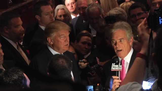 A shot to Trump entering the press conference and also talking with FoxNews after the conference