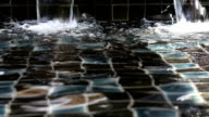 DOLLY Shot: Waterfall decorate in swimming pool