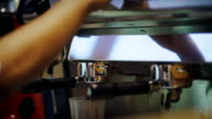2 Shots Coffee dripping from machine into cup by a Barista.