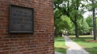 Shots in the area of Yale University referred to as the Old Campus in New Haven CT shot June 12 2015 Shots Shots pans to reveal a plaque honoring...