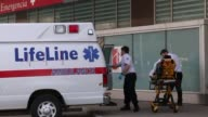 Shots of ambulances arriving at the ambulance dock for arriving emergency vehicles to the John H Stroger Jr Hospital of Cook County also know as...
