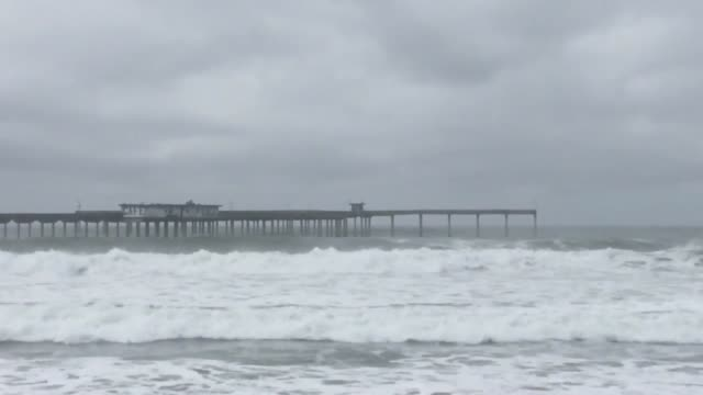Shots of big waves on the Pacific Ocean at a beach in the metro San Diego area