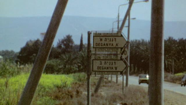 Shots of fields surrounding Kibbutz / Signage for Degania Alef and Bet / Kibbutz in Galilee on September 01 1974 in Degania Alef Israel