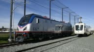 Shots of finished Siemens Industry Inc Manufactured Light Rail Trains in use on an Amtrak line in California Exterior shots of light rail train cars...