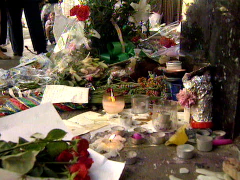 Shots of floral tributes and letters of condolence left outside Harrods department store for Diana Princess of Wales and Dodi Fayed 01 September 1997