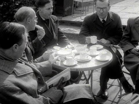 Shots of people having tea in an outdoor cafŽ 1953