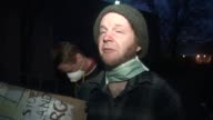Shots of protesters in front of Bullseye Glass Co in Portland Oregon Including two interviews with protesters that live in the neighborhood Bill...