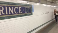Shots of stickers that fans placed on the subway station entrance signs to honor the late artist
