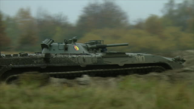 Shots of tank of the GDR army NVA while driving to shooting position / 1202007