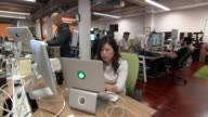 Shots of the Task Rabbit employees in San Francisco California on June 5 A tight shot of a young white male with a red beard working on a laptop A...