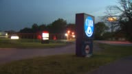 Shots of the two strip club signs and an interior shot of a woman dancing at one of the strip clubs in Harvey Ill on June 6 2014 WGN's reporter Mark...