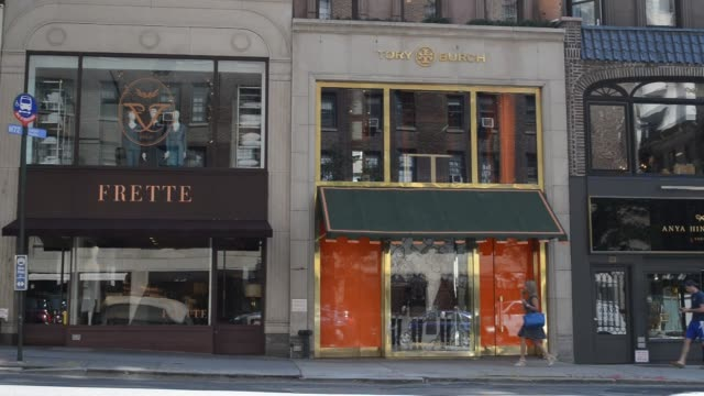 Shots of various stores and shops along Madison Avenue in Manhattan New York Shots pan across various lines of storefronts on Madison Avenue as...
