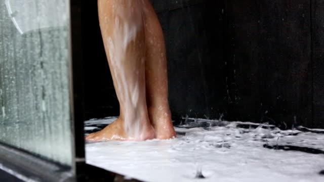 showering woman legs,dolly shot