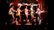 / showgirls in Gay 90s costume dance on bar Roaring 20s nightclub showgirls on January 01 1956 in Los Angeles California