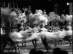 1965 MONTAGE Showgirls wearing feather headdresses performing at the Tropicana / Las Vegas, Nevada, United States