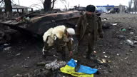 Showing Exterior shots of torn destroyed landscape of town of Debaltseve burnt out cars Pro Russian separatists Russian cossacks rebels separatists...