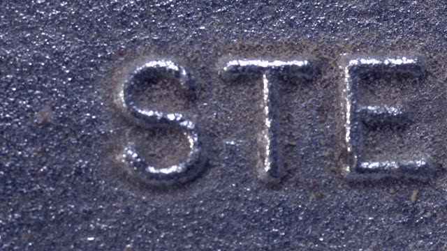 Steel shown in raised lettering on metal surface stock for Raised metal letters