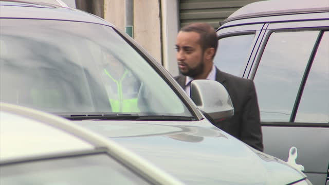 Shows aerial and exterior shots residents and police including forensics officers in housing estate in Newport where they arrested people in...