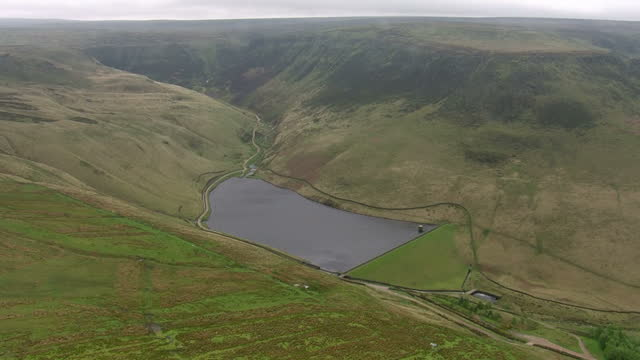 Shows aerial shots pan across lake and road on Saddleworth Moor Ian Brady one of the most notorious criminals in British history has died at the age...