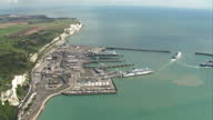 Shows aerial shots Port of Dover with ferries arriving and departing and police vehicle parked outside building within Port The UKs Threat Level was...