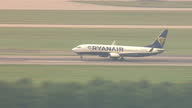 Shows aerial shots Ryanair plane taxiiing to end of runway and taking off from Stansted Airport Ryanair's boss Michael O'Leary has tried to limit...