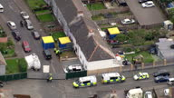 Shows aerial shots small housing estate in Stanwell with Heathrow Airport in background and police officers examining one of the properties in...