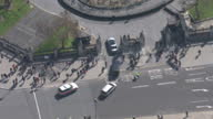 Shows aerial shots UK Prime Minister Theresa May leaving Number 10 Downing Street getting in car and motorcade driving from Downing Street to the...