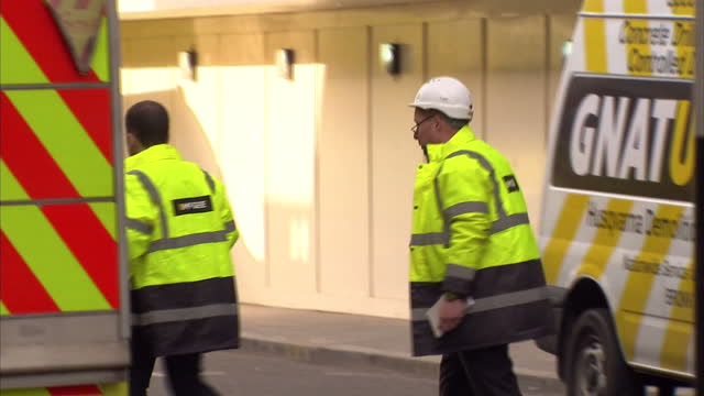 Shows aftermath police on scene with rescue workers and workmen on April 14 2014 in London England