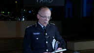 Shows exterior night shots Assistant Commissioner for Specialist Operations of the Metropolitan Police Service Mark Rowley at Press Conference...