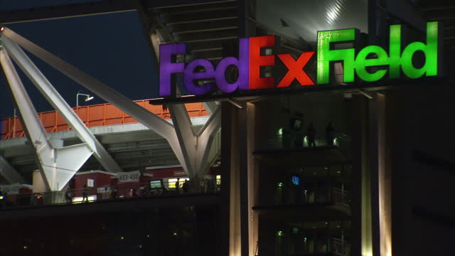 Shows exterior night shots Fedex Field Football Stadium lit up after match and cars in car park on 25th September 2017 in Washington DC USA