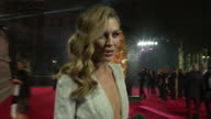 Shows exterior night shots interview with model and TV presenter Abbey Clancey speaking on highlight of year The Fashion Awards in partnership with...