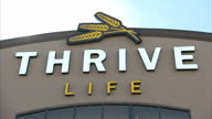 Shows exterior shot Thrive Life HQ signage interior shots tinned food canning processing line on October 16 2014 in Salt Lake City UT