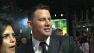 CLEAN Shows exterior shots actor Channing Tatum and his wife Jenna Dewan Tatum talking to press on the orange carpet at the World Premiere of...