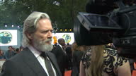 CLEAN Shows exterior shots actor Jeff Bridges talking to press on the orange carpet at the World Premiere of 'Kingsman The Golden Circle' held at...