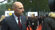 CLEAN Shows exterior shots actor Mark Strong talking to press on the orange carpet at the World Premiere of 'Kingsman The Golden Circle' held at...