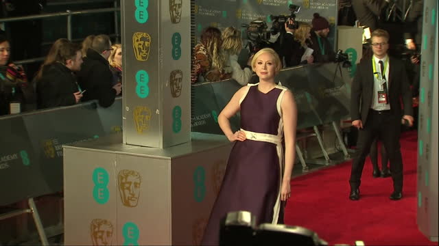 Shows Exterior shots actress Gwendoline Christie posing for photos on red carpet The 2016 BAFTAS Film Awards ceremony is to be held held at London's...