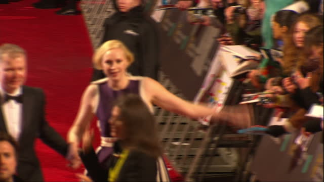 Shows Exterior shots actress Gwendoline Christie signing autographs and walking on red carpet The 2016 BAFTAS Film Awards ceremony at was held at...