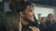 CLEAN Shows exterior shots actress Halle Berry signing autographs and talking to fans on the orange carpet at the World Premiere of 'Kingsman The...