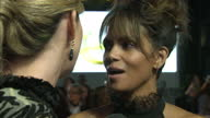 CLEAN Shows exterior shots actress Halle Berry talking to press on the orange carpet at the World Premiere of 'Kingsman The Golden Circle' held at...