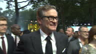 CLEAN Shows exterior shots actress Julianne Moore and actor Colin Firth speaking to each other and talking to the press on the orange carpet at the...