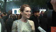 CLEAN Shows exterior shots actress Julianne Moore talking to press on the orange carpet at the World Premiere of 'Kingsman The Golden Circle' held at...