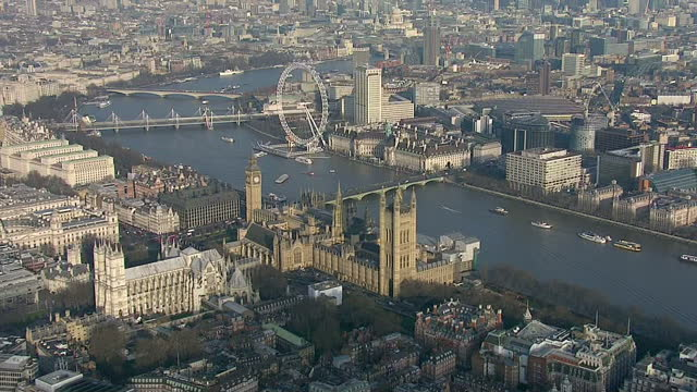 Shows exterior shots aerials Big Ben Elizabeth Tower pan out to the Palace of Westminster on January 20 2015 in London England